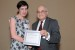 "Dr. Nagib Callaos, General Chair, giving Dr. Caroline Sheedy the best paper award certificate of the session ""Knowledge Management and Risk Management."" The title of the awarded paper is ""The Impact of Signature Pedagogy for Women in Information Sciences."""