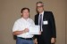 "Dr. Andrés Tremante, IMSCI 2012 General Co-Chair, giving Mr. David Gore the best paper award certificate of the session ""Education and Information Technologies."" The title of the awarded paper is ""Learning to Baseline Business Technology."""